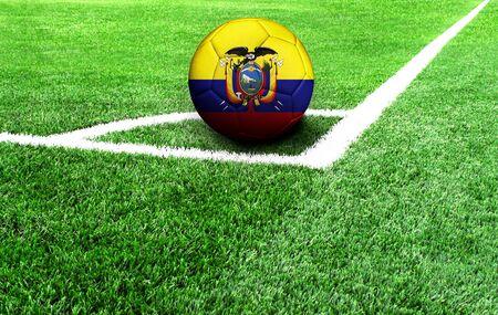 soccer ball on a green field, flag of Ecuador Stockfoto