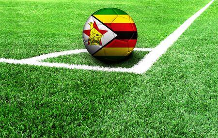 soccer ball on a green field, flag of Zimbabwe