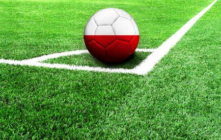 soccer ball on a green field, flag of Poland