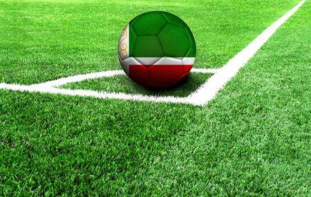 soccer ball on a green field, flag of Chechen Republic Stockfoto