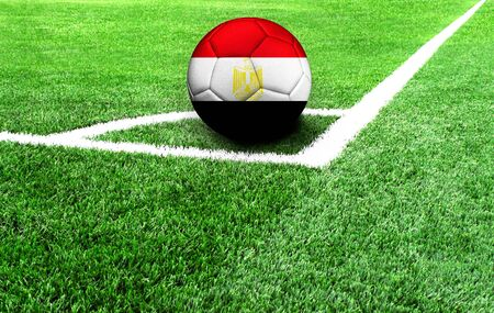 soccer ball on a green field, flag of Egypt