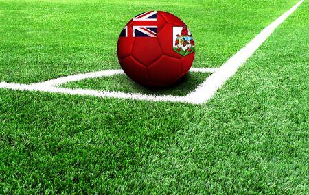 soccer ball on a green field, flag of Bermuda Islands