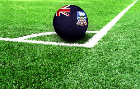 soccer ball on a green field, flag of Falkland Islands