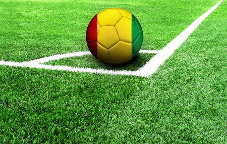 soccer ball on a green field, flag of Guinea