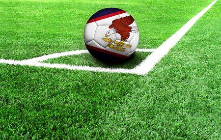 soccer ball on a green field, flag of American Samoa