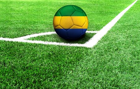soccer ball on a green field, flag of Gabon 스톡 콘텐츠
