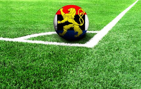 soccer ball on a green field, flag of Benelux