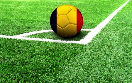 soccer ball on a green field, flag of Chad