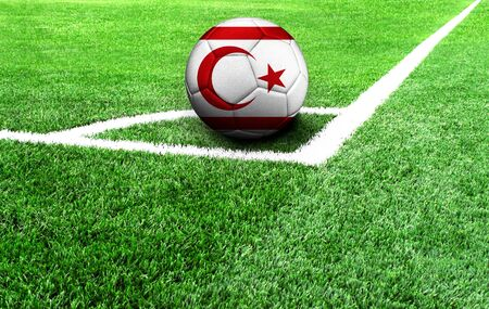 soccer ball on a green field, flag of Turkish Republic of Northern Cyprus