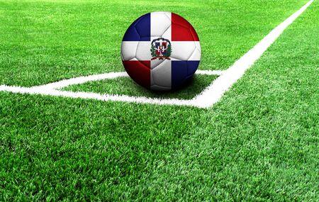 soccer ball on a green field, flag of Dominican Republic Standard-Bild
