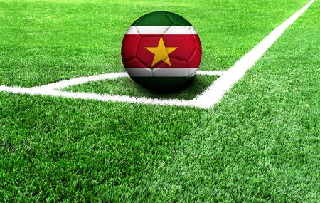 soccer ball on a green field, flag of Suriname