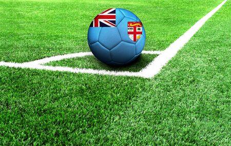 soccer ball on a green field, flag of Fiji