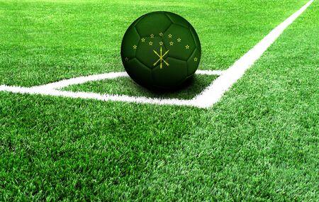 soccer ball on a green field, flag of Adygea