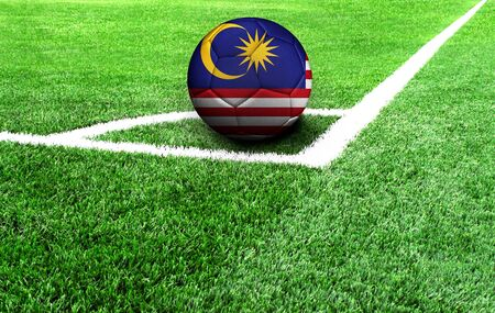 soccer ball on a green field, flag of Malasia
