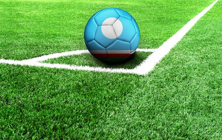 soccer ball on a green field, flag of Sakha Republic