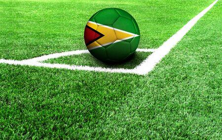 soccer ball on a green field, flag of Guyana