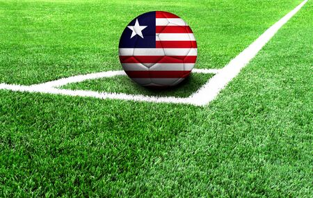 soccer ball on a green field, flag of Liberia Stockfoto