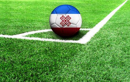 soccer ball on a green field, flag of Mari El