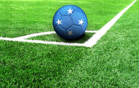 soccer ball on a green field, flag of Micronesia Stockfoto