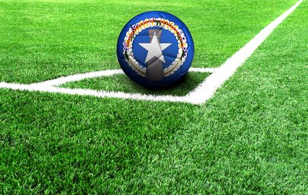 soccer ball on a green field, flag of Northern Mariana Islands