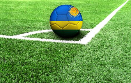 soccer ball on a green field, flag of Rwanda