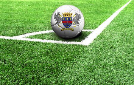 soccer ball on a green field, flag of Saint Barthelemy