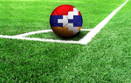 soccer ball on a green field, flag of Nagorno Karabakh Republic