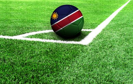 soccer ball on a green field, flag of Namibia Stockfoto