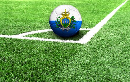 soccer ball on a green field, flag of San marino