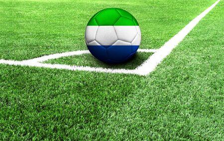 soccer ball on a green field, flag of Sierra Leone Stockfoto