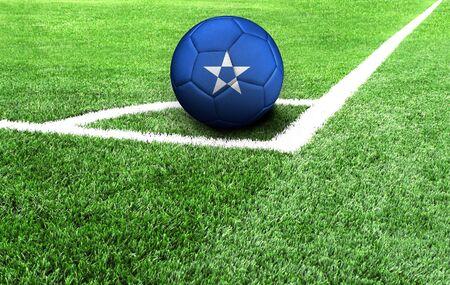 soccer ball on a green field, flag of Somalia Stockfoto