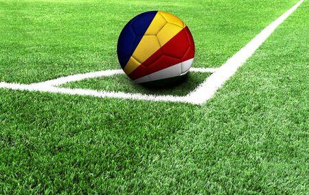 soccer ball on a green field, flag of Seychelles Stockfoto