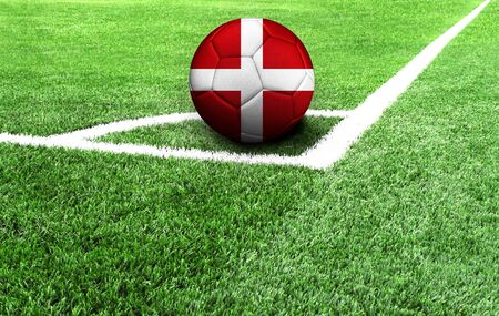 soccer ball on a green field, flag of Sovereign Military Order of Malta