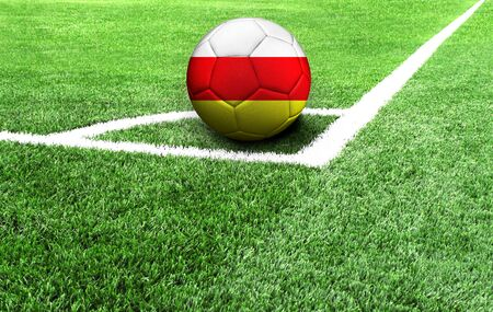 soccer ball on a green field, flag of South Ossetia Stockfoto