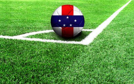 soccer ball on a green field, flag of Netherlands Antilles