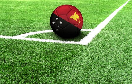 soccer ball on a green field, flag of Papua New Guinea