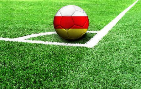 soccer ball on a green field, flag of North Ossetia Stockfoto