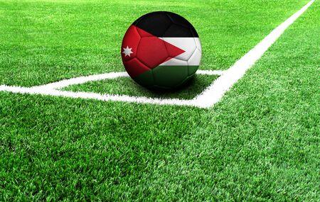 soccer ball on a green field, flag of Jordan