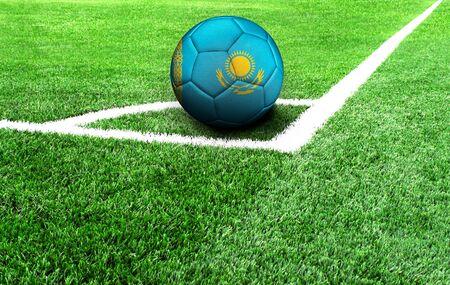 soccer ball on a green field, flag of Kazakhstan