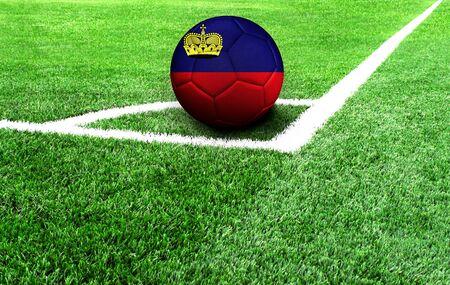 soccer ball on a green field, flag of Liechtenstein