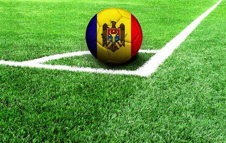 soccer ball on a green field, flag of Moldova Stockfoto
