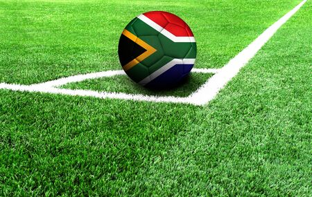 soccer ball on a green field, flag of South Africa