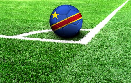 soccer ball on a green field, flag of Congo Democratic Standard-Bild