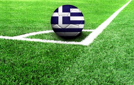 soccer ball on a green field, flag of Greece Stockfoto
