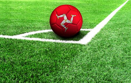 soccer ball on a green field, flag of Isle Of Man