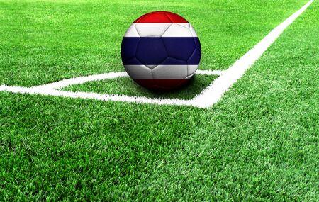 soccer ball on a green field, flag of Thailand Standard-Bild