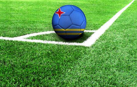 soccer ball on a green field, flag of Aruba