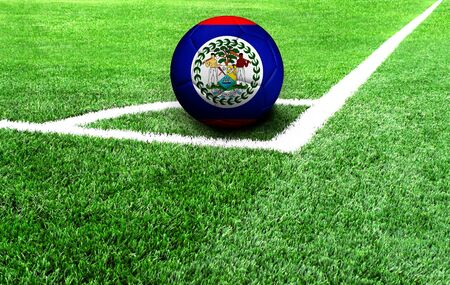 soccer ball on a green field, flag of Belize Stockfoto