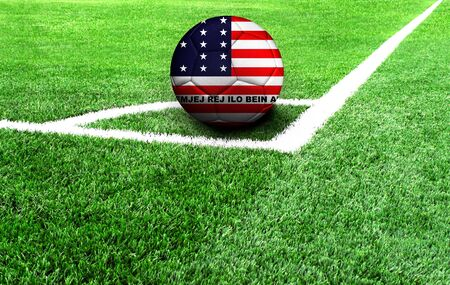 Fußball auf einer grünen Wiese, Flagge des Bikini-Atolls Standard-Bild