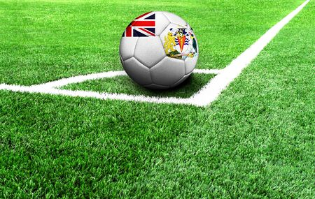 soccer ball on a green field, flag of British Antarctic Territory